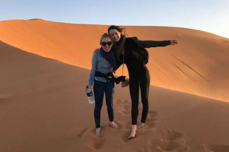 Image of doctoral student Maggie Neel in the desert (with a friend)