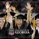 photo of UGA graduates in cap and gown, cheering at graduation